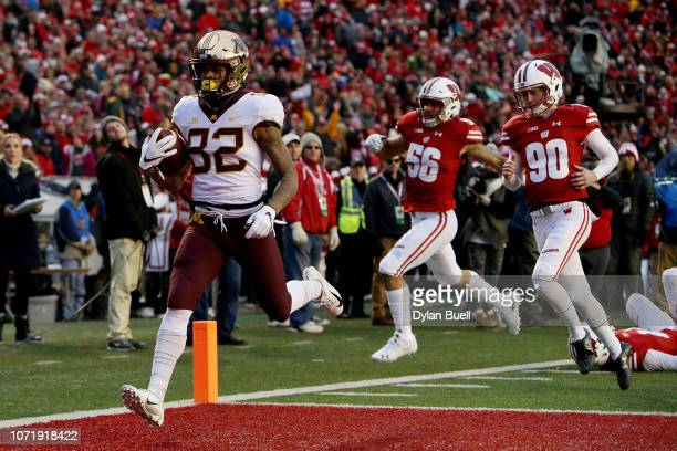 Demetrius Douglas of the Minnesota Golden Gophers scores a touchdown on a punt return in the second quarter against the Wisconsin Badgers at Camp...