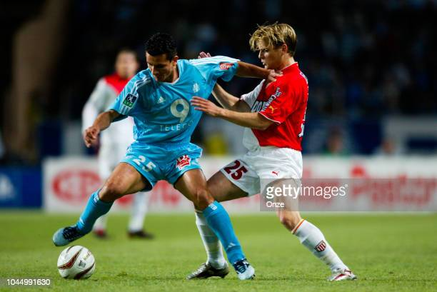 Demetrius FERREIRA / Jerome ROTHEN during the Ligue 1 match between Monaco and Marseille on May 9 2004 in Monaco