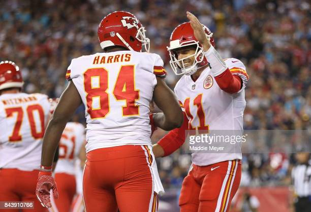 Demetrius Harris and Alex Smith of the Kansas City Chiefs celebrate scoring a touchdown during the first quarter against the New England Patriots at...