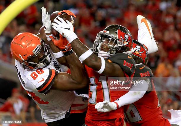 Demetrius Harris of the Cleveland Browns has a pass broken up by Jordan Whitehead of the Tampa Bay Buccaneers during a preseason game at Raymond...