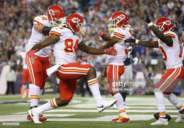 Demetrius Harris of the Kansas City Chiefs celebrates with teammates after scoring a touchdown during the first quarter against the New England...