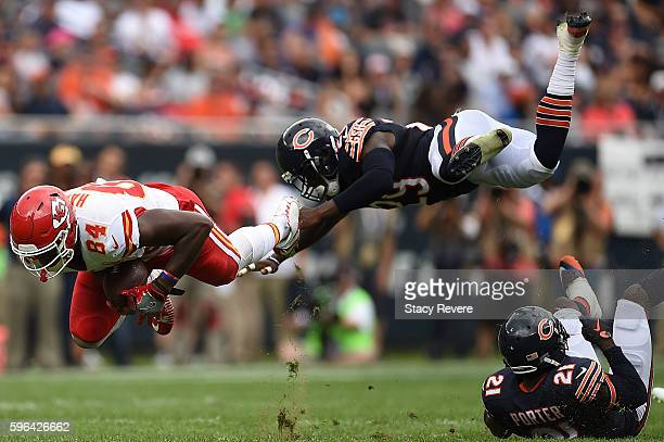 Demetrius Harris of the Kansas City Chiefs is tripped up by Harold Jones-Quartey of the Chicago Bears during a preseason game at Soldier Field on...