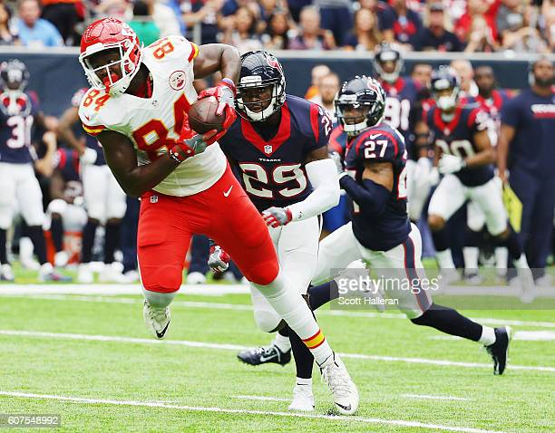 Demetrius Harris of the Kansas City Chiefs reaches for the football in front of Andre Hal and Quintin Demps of the Houston Texans in the second...