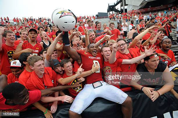 Demetrius Hartsfield of the Maryland Terrapins celebrates with fans after a victory against the William Mary Tribe at Byrd Stadium on September 1...
