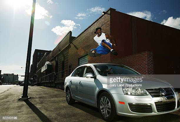 Demetrius Hook Mitchell jumps over a car during a Volkswagen event during NBA All Star Weekend February 19 2005 in Denver Colorado