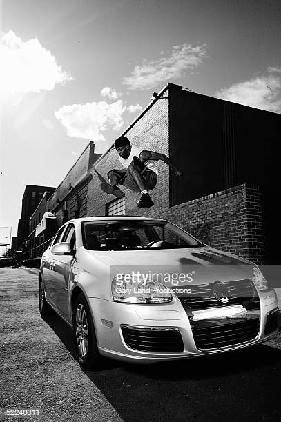 Demetrius 'Hook' Mitchell jumps over a car during a Volkswagen event during NBA All Star Weekend February 19 2005 in Denver Colorado