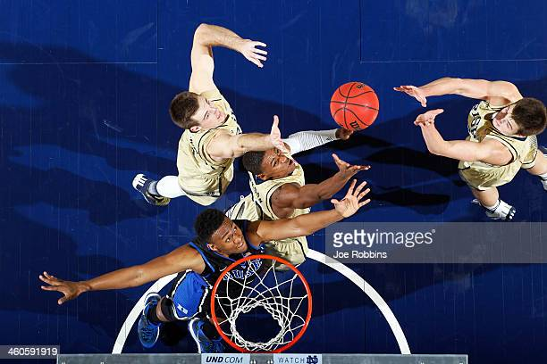 Demetrius Jackson and Pat Connaughton of the Notre Dame Fighting Irish rebound over Jabari Parker of the Duke Blue Devils during the game at Purcell...
