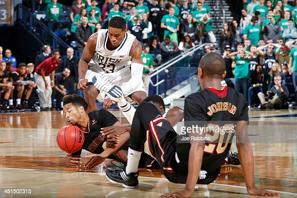 Demetrius Jackson of the Notre Dame Fighting Irish battles for a loose ball against Brandon Clark of the Santa Clara Broncos during the game at...