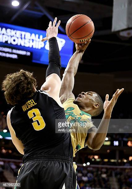Demetrius Jackson of the Notre Dame Fighting Irish drives to the basket against Evan Wessel of the Wichita State Shockers in the first half during...