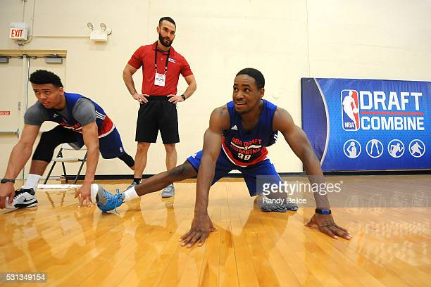 Demetrius Jackson stretches with Wade Baldwin IV under the watchful eye of Chris Chase of the Atlanta Hawks during 2016 NBA Draft Combine on May 12...