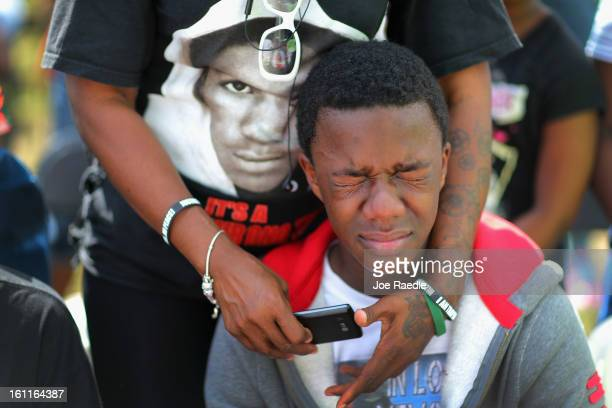 """Demetrius Martin cries as he remembers his brother, Trayvon Martin, during the """"March for Peace"""" at Ives Estate Park in honor of the late Trayvon..."""