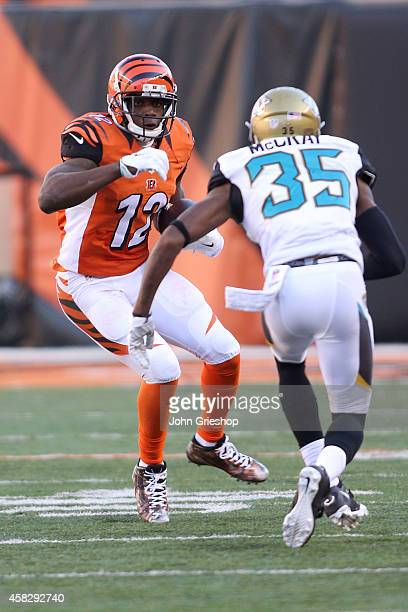 Demetrius McCray of the Jacksonville Jaguars attempts to tackle Mohamed Sanu of the Cincinnati Bengals during the third quarter at Paul Brown Stadium...