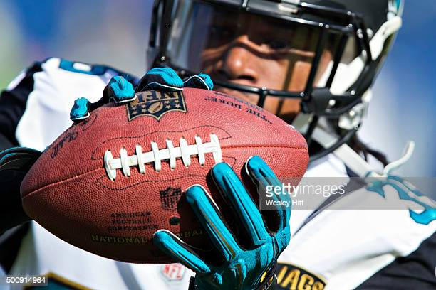 Demetrius McCray of the Jacksonville Jaguars catching passes while warming up before a game against the Tennessee Titans at Nissan Stadium on...