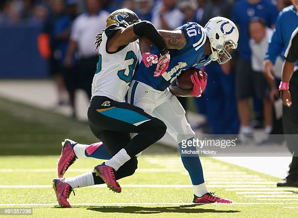 Demetrius McCray of the Jacksonville Jaguars makes the tackle on Donte Moncrief of the Indianapolis Colts at Lucas Oil Stadium on October 4 2015 in...