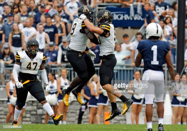 Demetrius Taylor of the Appalachian State Mountaineers celebrates his sack with Jordan Fehr on September 1 2018 at Beaver Stadium in State College...