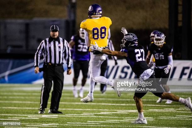 Demetrius Taylor of the University of Mary HardinBaylor catches a pass in front of Gabe Brown of the University of Mount Union during the Division...