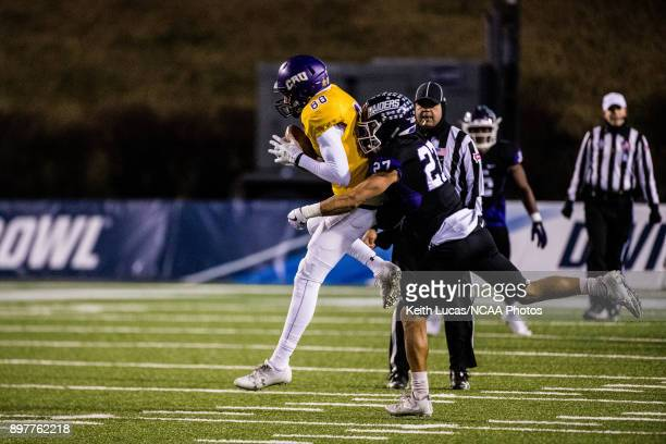 Demetrius Taylor of the University of Mary HardinBaylor is tackled by Gabe Brown of the University of Mount Union during the Division III Men's...