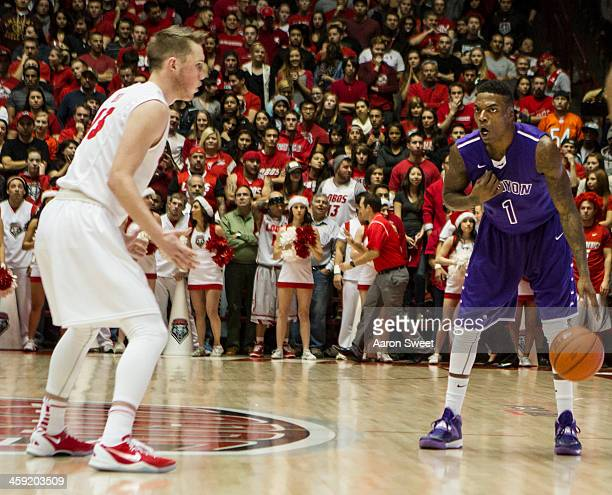 Demetrius Walker of the Grand Canyon Antelopes slows down the pace during the game against the New Mexico Lobos at The Pit on December 23 2013 in...