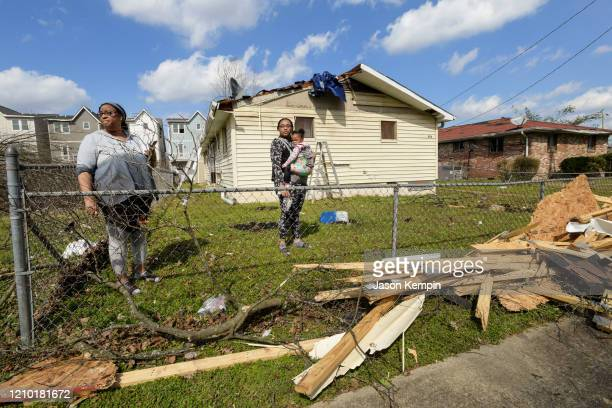Demetrius Wide Dominique Hammond and her daughter Analise Hammond are seen outside their home in North Nashville following devastating tornadoes on...