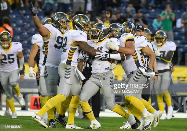 DemetriusWright of the San Diego Fleet celebrates with teammates after intercepting a pass during the third quarter against the Birmingham Iron in...