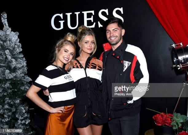 Demi Burnett Hannah Godwin and Dylan Barbour attend GUESS Kicksoff Holiday Season at The Peppermint Club on November 07 2019 in Los Angeles California