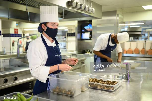 Demi Chef de Partie Megan Coape-Arnold and Demi Chef de Partie Nikesh Patel prepare fresh ingredients in the kitchens at The Ritz London on May 13,...