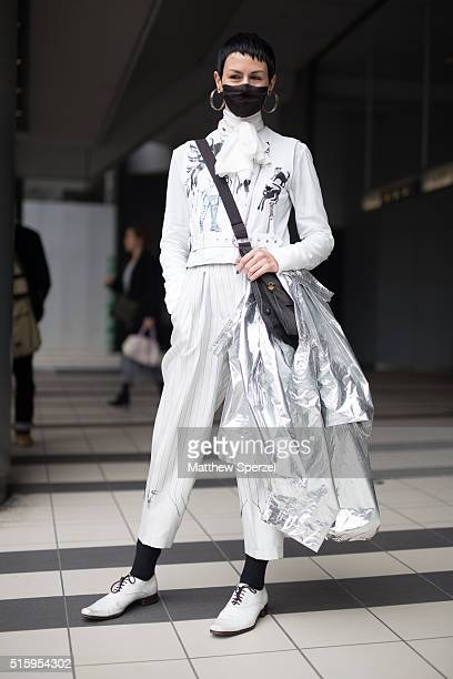 Demi Demu attends the Anne Sofie Madsen show during Tokyo Fashion Week wearing a Claire Barrow jacket Doublet pants vintage shoes and Margielabag on...