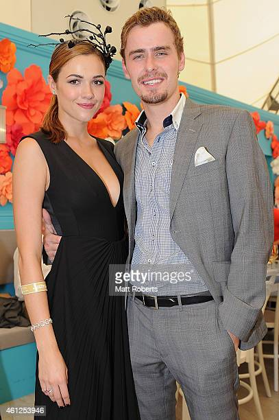 Demi Harman and Alec Snow pose during Magic Millions Race Day at Gold Coast Racecourse on January 10 2015 on the Gold Coast Australia