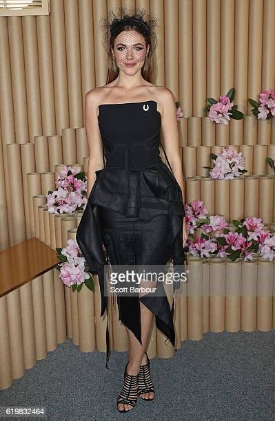 Demi Harman poses at the Lexus Marquee on Melbourne Cup Day at Flemington Racecourse on November 1 2016 in Melbourne Australia