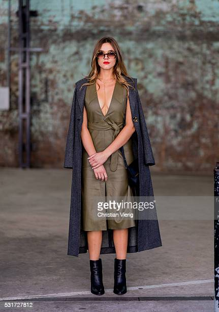 Demi Harman wearing a a green Kate Sylvester leather dress Miu Miu sunglasses at MercedesBenz Fashion Week Resort 17 Collections at Carriageworks on...
