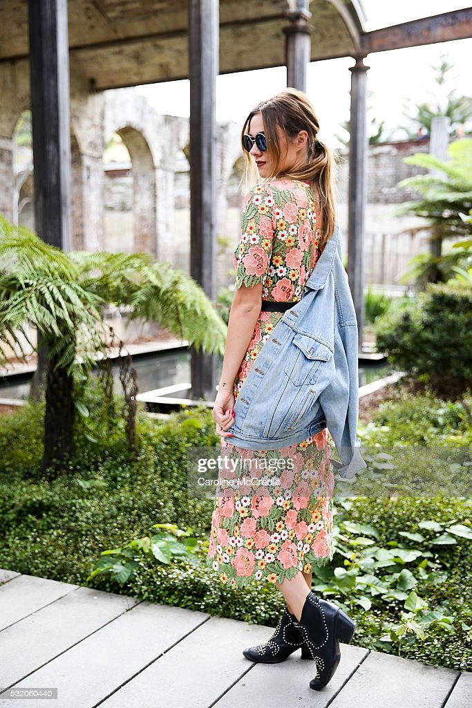 Demi Harmon, wearing Kate Sylvester dress, Vintage jacket and Jeffrey Campbell shoes, arrives ahead of the KITX show at Mercedes-Benz Fashion Week Resort 17 Collections at Paddington Reservoir on May 18, 2016 in Sydney, New South Wales.