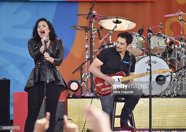 Demi Lovato and Brad Paisley perform on ABC's Good Morning America at SummerStage at Rumsey Playfield Central Park on June 17 2016 in New York City