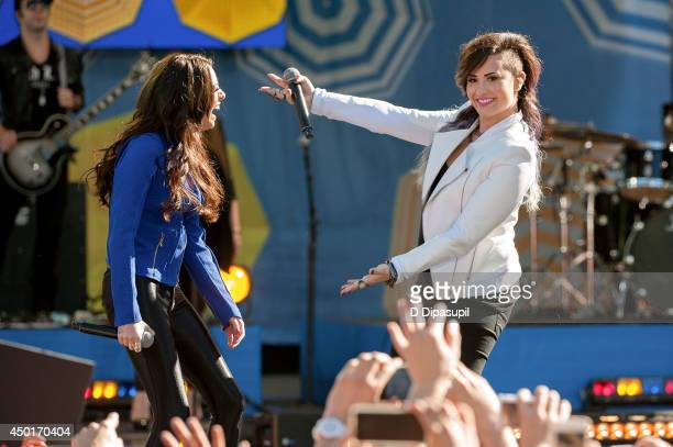 Demi Lovato and Cher Lloyd perform on ABC's 'Good Morning America' at Rumsey Playfield on June 6 2014 in New York City