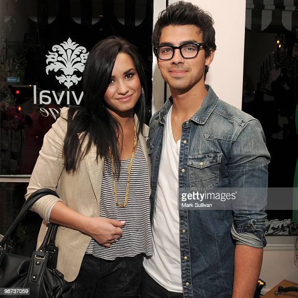 Demi Lovato and Joe Jonas attend the grand opening of boutique Revival Vintage on April 28 2010 in Los Angeles California