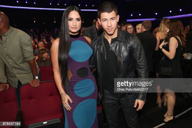 Demi Lovato and Nick Jonas during the 2017 American Music Awards at Microsoft Theater on November 19 2017 in Los Angeles California