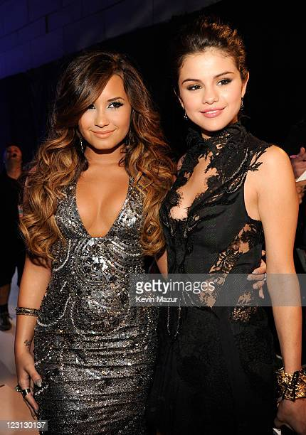 Demi Lovato and Selena Gomez arrive at the The 28th Annual MTV Video Music Awards at Nokia Theatre LA LIVE on August 28 2011 in Los Angeles California