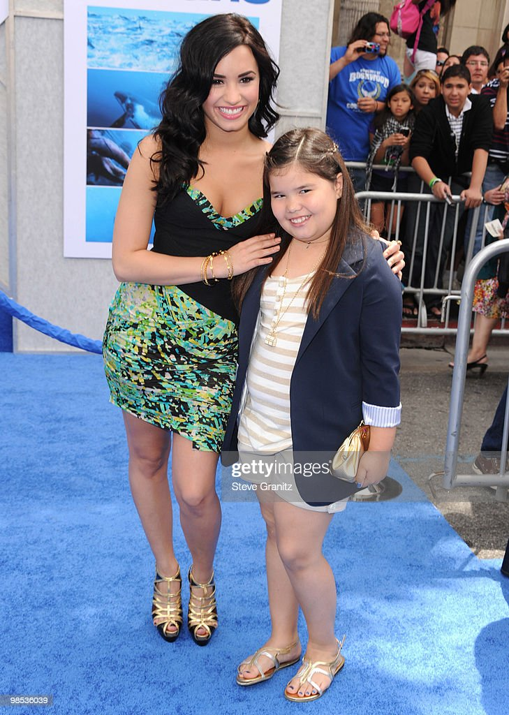 Demi Lovato and sister Madison De La Garza attends the 'Oceans' Los Angeles Blue Carpet Premiere at the El Capitan Theatre on April 17, 2010 in Hollywood, California.