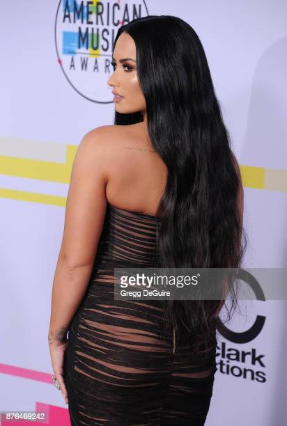Demi Lovato arrives at the 2017 American Music Awards at Microsoft Theater on November 19 2017 in Los Angeles California