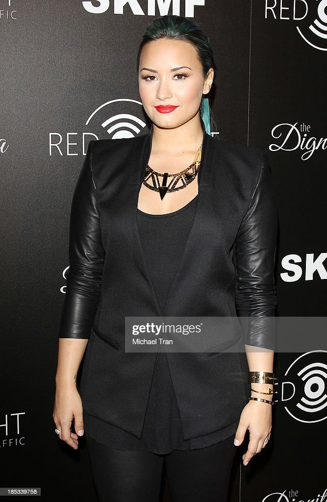 Demi Lovato arrives at the launch of the Redlight Traffic APP - Dignity Gala held at The Beverly Hilton Hotel on October 18, 2013 in Beverly Hills, California.
