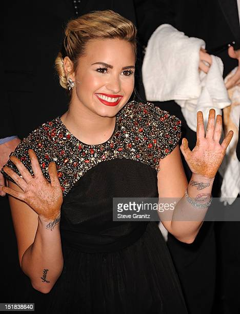 Demi Lovato arrives at the The X Factor Season 2 Premiere Party at Grauman's Chinese Theatre on September 11 2012 in Hollywood California
