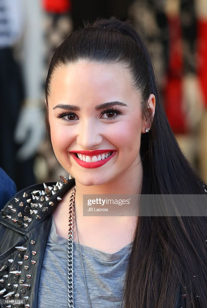 Demi Lovato attends Topshop Topman LA Grand Opening at The Grove on February 14, 2013 in Los Angeles, California.