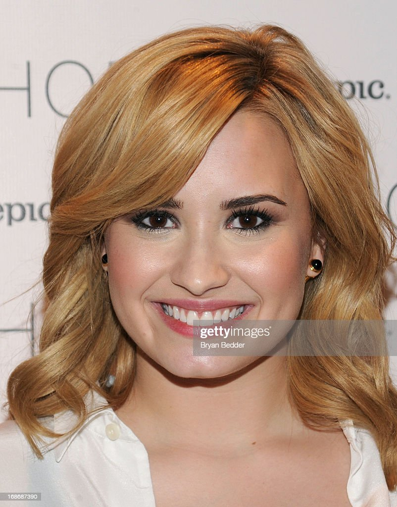 Demi Lovato attends X Factor's Topshop photo call with Demi Lovato & 5th Harmony on May 13, 2013 in New York City.