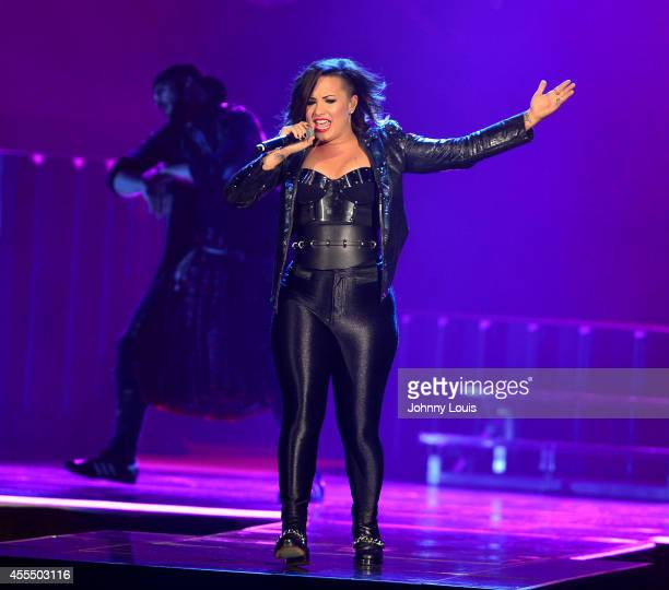 Demi Lovato performs at American Airlines Arena on September 14 2014 in Miami Florida