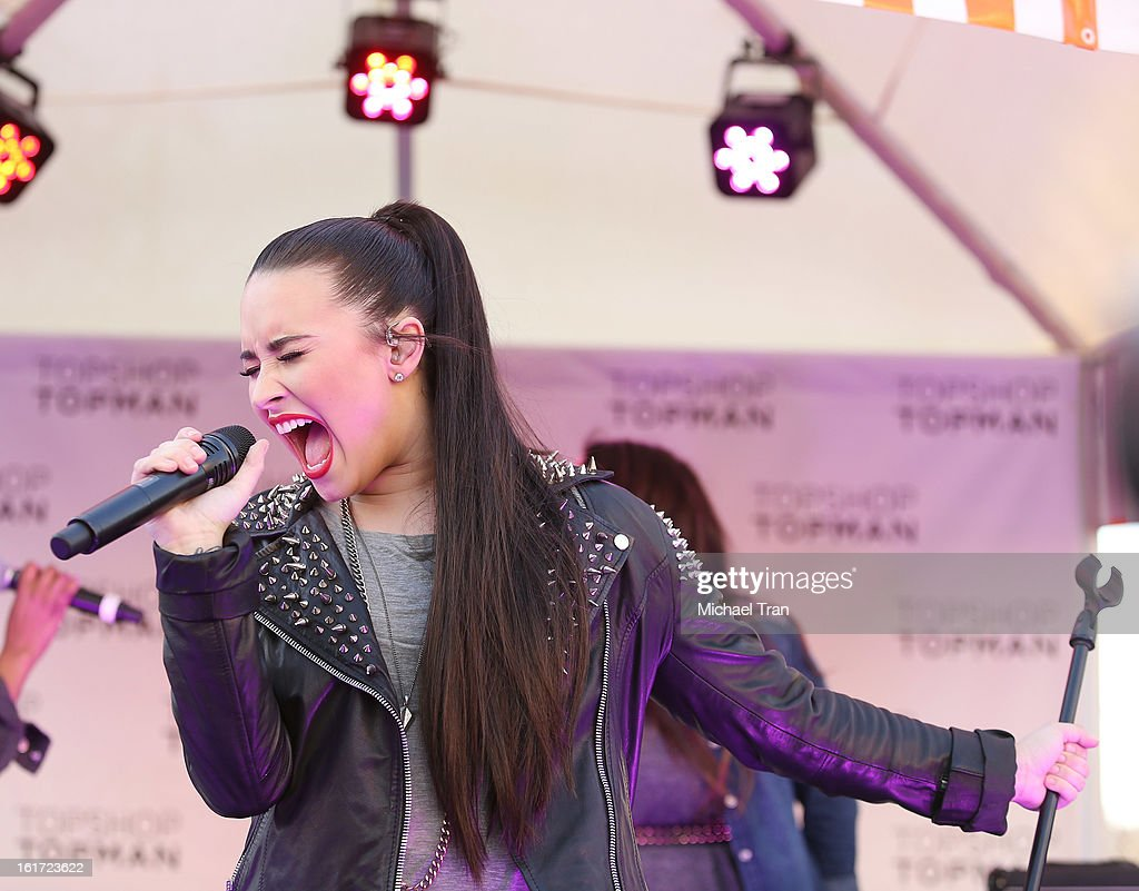 Demi Lovato performs at Topshop Topman LA Grand Opening at The Grove on February 14, 2013 in Los Angeles, California.