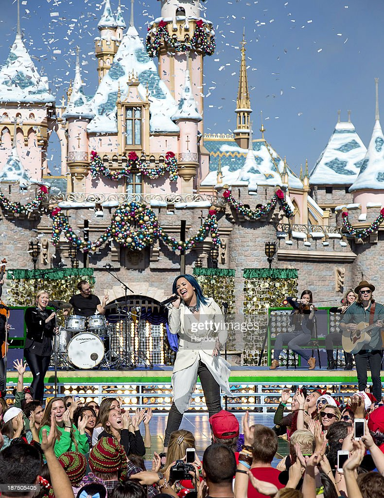 Demi Lovato performs 'Let it Go' from the upcoming animated feature, 'Frozen,' during a taping for the 'Disney Parks Christmas Day Parade' television special at Disneyland on November 9, 2013 in Anahiem, California. 'Disney Parks Christmas Day Parade' airs December 25 on ABC.