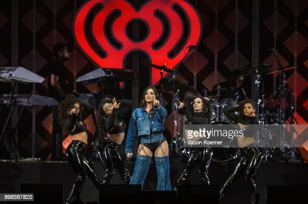 Demi Lovato performs on stage at the IHeartRadio Jingle Ball 2017 at BBT Center on December 17 2017 in Sunrise Florida