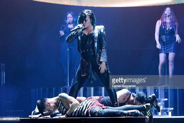 Demi Lovato performs on stage at United Center on October 14 2014 in Chicago Illinois