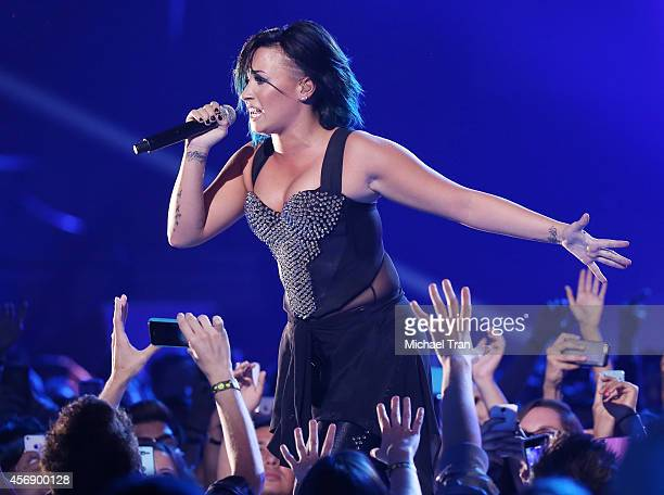 Demi Lovato performs onstage at the Vevo CERTIFIED SuperFanFest held at Barker Hangar on October 8 2014 in Santa Monica California