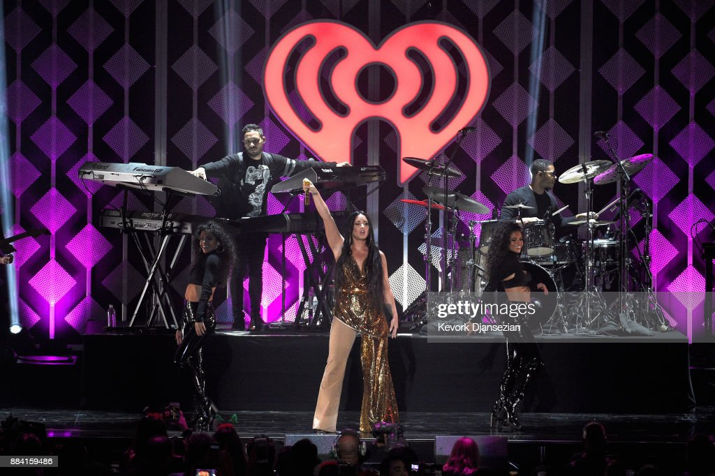 Demi Lovato (C) performs onstage during 102.7 KIIS FM's Jingle Ball 2017 presented by Capital One at The Forum on December 1, 2017 in Inglewood, California.