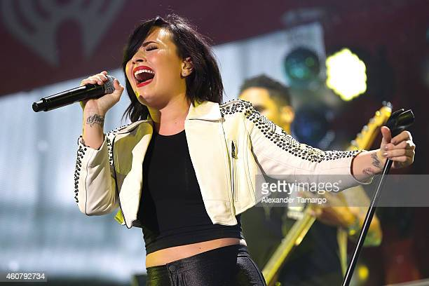 Demi Lovato performs onstage during 93.3 FLZ's Jingle Ball 2014 at Amalie Arena on December 22, 2014 in Tampa, Florida.